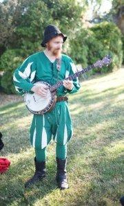 Harper Stone, director (with banjo)